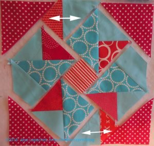 Sew small red triangles to solid triangles