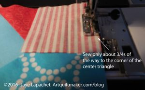 Sew about 3/4s of the way down the center square seam