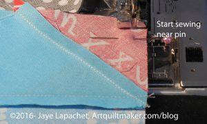 Start sewing near pin - detail