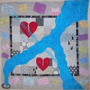 Down the Drain: basted and ready to quilt