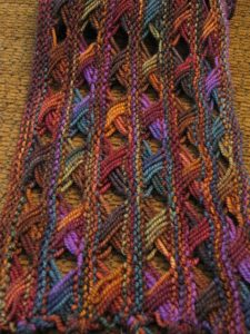 Koigu Cross Stitch Scarf by DoublePointed Designs (https://www.ravelry.com/patterns/library/koigu-cross-stitch-scarf)