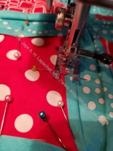 Sew close to the edge of the background fabric