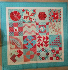 Aqua-Red Sampler, quilted & ready for binding