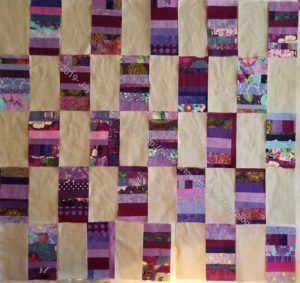 Purple strip donation quilt with grey solid