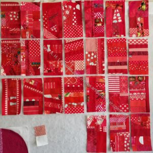 24 Red Strip donation blocks for second red quilt